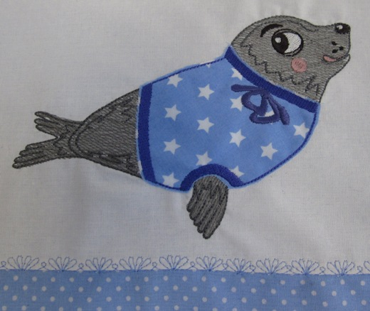 "embroidery design ""seal with pullover"""