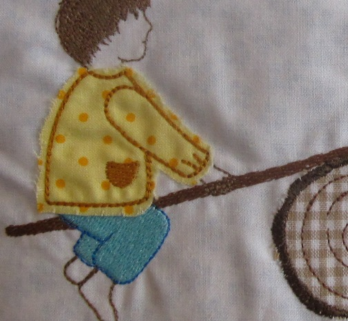 embroidery design children on seesaw